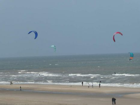 You can see the surf-kites in the air, and the kite-surfer in the sea!