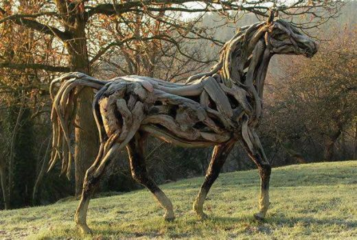 An artist captures a horse with dead wood
