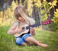 GIRL PLAYING HER GUITAR