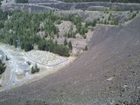 atop the earthen dam, looking down at the other side