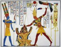 Ramesses II about to sacrifice prisoners to god Amun-Re