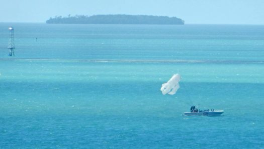 (43) Looks like preparation for water-skiing via parachute host, Caribbean, 2018