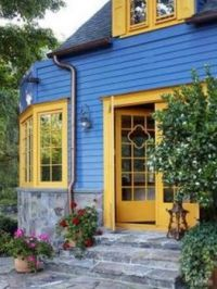 Blue Building With A Yellow Entrance
