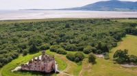 A site at Caerlaverock was abandoned and replaced by one built on higher ground.