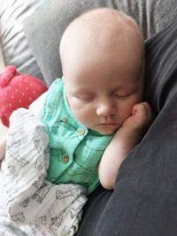 Dot sleeping on Uncle Dan