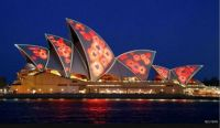 Red poppies are projected on to the sails of the Sydney Opera House in Australia
