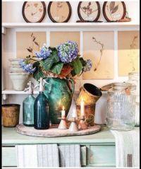 Seltzer bottles, candles, and hydrangeas