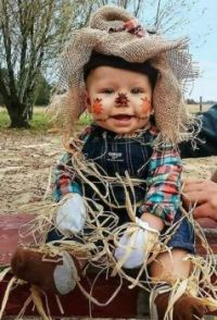 One little scarecrow, come cowboy farmer is all set and ready to go.