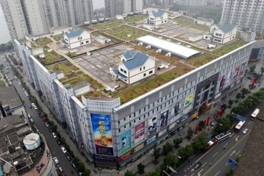 houses built on roof of shopping mall, China