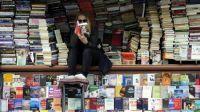 woman-reading-at-bookstore-e1475052501132