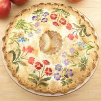 Apply cinnamon sugar or powdered food colors on your rolled out pie crust top then bake as usual