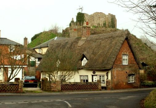 Thatched cottage with Eye Castle behind, Suffolk.  Photo by Robert Edwards