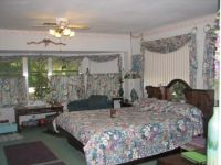 Theme:  Homes   My bedroom.  You can see one of the school desks in this photo.  It's an old platform waterbed.
