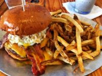Bacon cheeseburger with a fried egg and French fries