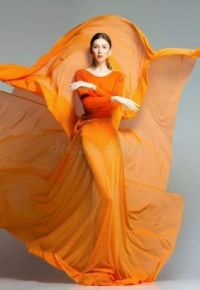 Lady wearing  a nasturtium-coloured  dress