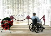 US_Navy_Pearl_Harbor_survivor_stares_at_the_list_of_names_inscribed_in_the_USS_Arizona_Memorial