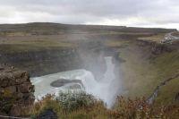 Waterfall, deep ravine, mist, Iceland, Sep 2019