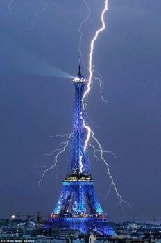 Eiffel Tower being struck by lightning.