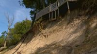 weather - home dangles over eroded dune