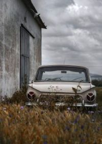 Old car and an old building