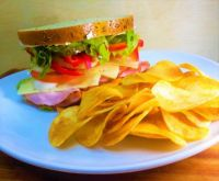 Ham and Swiss Cheese on Rye with homemade chips