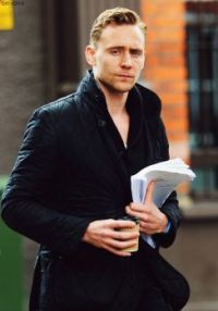Tom Hiddleston looking uncharacteristically sombre