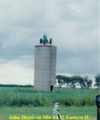 Tractor on top of silo