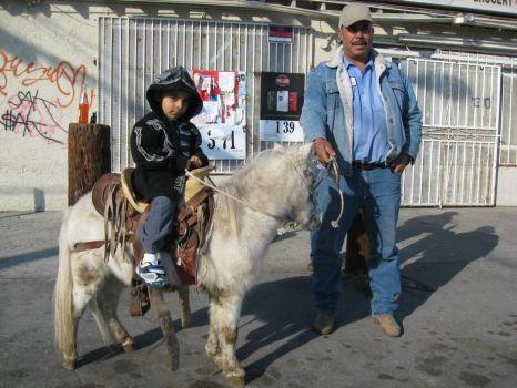 Boy on pony - Muscoy, CA