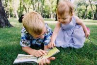 Connor reading book to sister Kylie