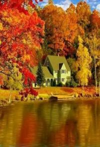 a home along the river against a backdrop of fall colours