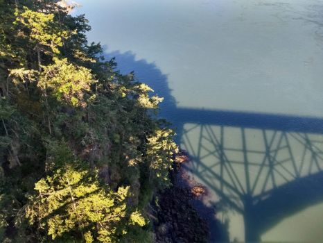 Deception Pass bridge shadow taken from middle of the span