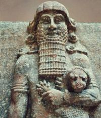 Stone relief of an Assyrian warrior and his lion.
