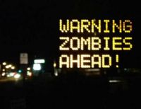 Real Road Construction Sign in Maine!!!  Some think a person changed it but I bet a Zombie did.