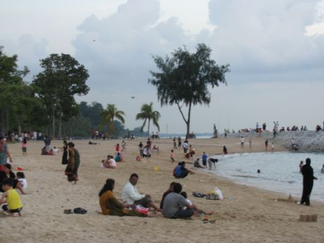 Picnickers cooling off by the seashore