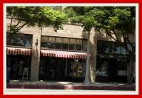 Shops with red & white awning. . . . . . .