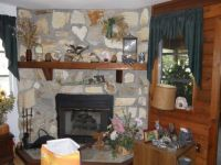 Theme:  Homes   The fireplace in my living room.  Note the heart stone my brother put in it.  Sorry about the dog food bag.