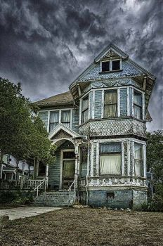 Abandoned Victorian Under a Threatening Sky