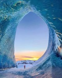 An ice cave in Iceland that looks like a wave.