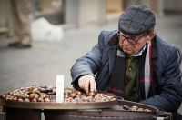 Old man selling chestnuts