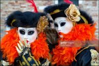 Venetian Women in Carnival costume and masks