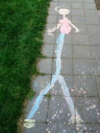 Liquid sidewalk chalk 6 yr olds drawing of me,