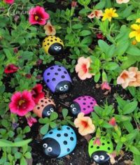Painted animal rocks in a garden