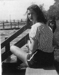Mimi age 13 or 14 on the seawall by Lake Ponchartrain in Mandeville LA