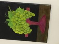 Green Grapes on red pedastel