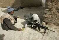 afghan man offers tea to a soldier