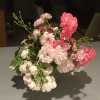 Five different types of tiny to small roses make up this cheerful arrangement