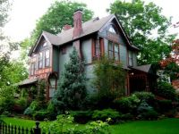 Lovely Victorian home surrounded by greenery