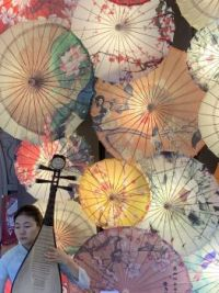 Woman with parasols