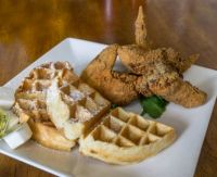 a waffle with hot chicken served at Felix's BBQ with Soul in Oceanside, CA