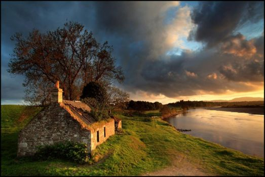 Old stone house by the river